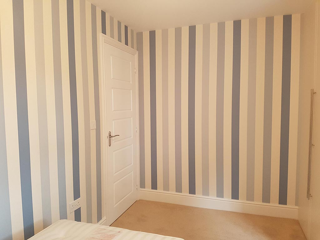 Bedroom in solihull with blue striped wallpaper
