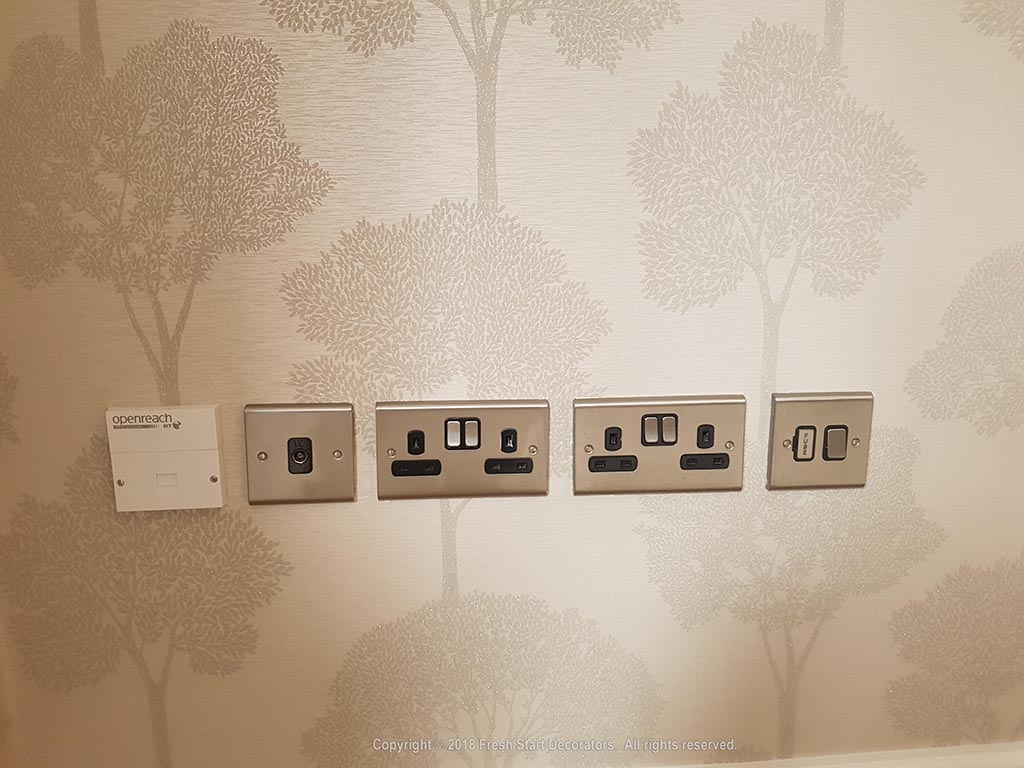 wallpaper applied around switches